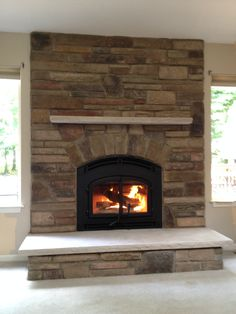 http://www.myair1.com/ beautiful, stackstone with harth/fireplace and mantle