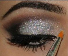 Sparkly silver eyeshadow with a smoky eye is suitable for latin and standard. Also note the darkened brow and big lashes. Visit http://ballroomguide.com/comp/hair_make_up.html for more hair and makeup info
