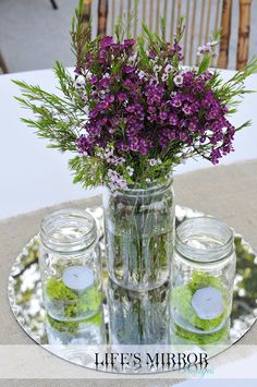 simple centerpieces. I love how simple this is, the mirror is great an would look awesome w the turquoise vases and glass tables.
