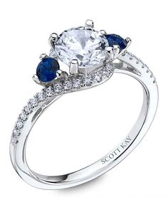 Ladies platinum engagement ring with round blue sapphires | http://trib.al/W7Xbn4T