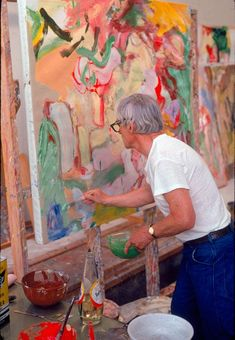 De Kooning in his studio, with a bottle of safflower oil and bowls of paint on his worktable, 1971. Photo Dan Budnik.