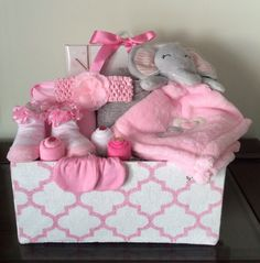 Your little cutie pie will be absolutely adorable! Includes: 35 size 1 Huggies diapers, a pair of bootie socks, pink brush and comb set, 7 washcloths, 2 Gerbers onesies (size 3-6 months and 6-9 months