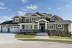 Time to paint the house this spring - love this exterior color with white trim and stone.
