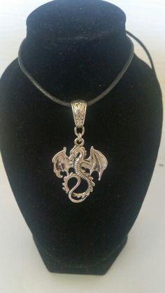 Antique silver dragon on cord. AUS $ 9.00