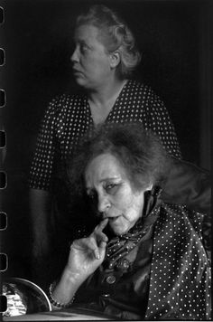 Henri Cartier-Bresson FRANCE. Paris. 1952. French writer COLETTE, at her home in the Palais Royal, with her nurse, Pauline