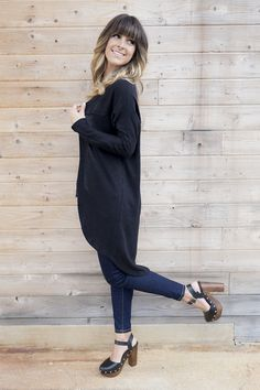 """Our Cady Cardi layers perfectly with just about anything. Long sleeve ribbed cardigan with seam detail. 70% Cotton. 30% Rayon Knit. Model is wearing a size small and is 5'5"""". True to size."""