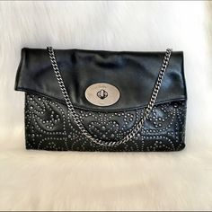 """‼️CCO‼️Coach Black Leather Shoulder Bag NWT. Gorgeous Coach black leather studded envelope clutch wallet bag. Perfect condition. Made of the softest leather. Silver hardware studded design. Chain for shoulder use. Measures 14.5x9"""". Coach Bags Shoulder Bags"""