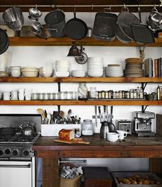 Who needs cabinets, stock pans on these rustic kitchen shelves
