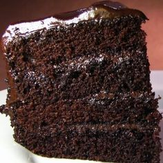 This moist chocolate layer cake recipe makes a rich, moist cake and is filled and coated with chocolate ganache. Moist Chocolate Layer Cake Recipe from Grandmothers Kitchen. Chocolate Ganache Cake, Dark Chocolate Cakes, Chocolate Desserts, Chocolate Birthday Cake For Men, Super Moist Chocolate Cake, Baking Chocolate, Chocolate Bomb, Melted Chocolate, Food Cakes