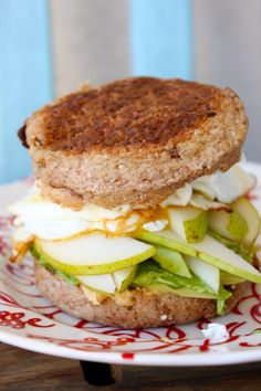 Hungry Mama's egg Sammy- egg spinach hummus pesto avocado pear slices, on a whole wheat english muffin