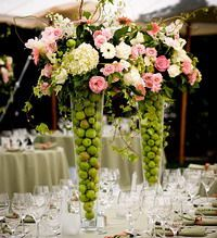 loving the limes in these tall flower arrangements.  Such a lovely combination of fruit and flowers, and the colors really pop.  a unique and lovely statement.