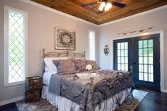 Check out this newly renovated master bedroom with a wood paneling on the ceiling on HGTV.com.