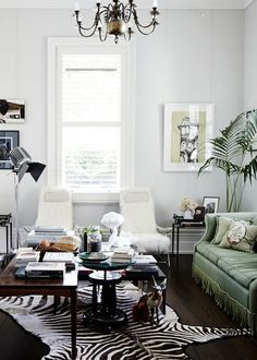 living room, white, zebra, classic, chandelier, palm, antiques (Melbourne home of Caecilia & James Potter)