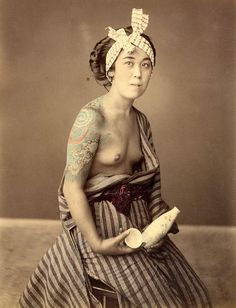 Tattooed woman with a sake bottle, ca. 1860s #inkedlady #tattooedwomen #oldphotograph