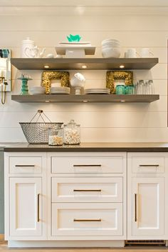 Kitchen With Wall To Base Cabinets Topped Dark Gray Countertops Under Floating Shelves Ed Lighting In Lieu Of Upper
