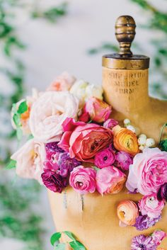 Vibrant florals on a vintage dress form by Amy Osaba Events, image by Rustic White Photography. #wedding
