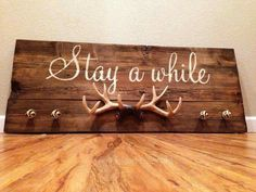 Stay a while wood antlers and knobs sign. All hand painted and handmade. For the game room Home Projects, Home Crafts, Diy Home Decor, Diy And Crafts, Hunting Home Decor, Hunting Gifts, Country Decor, Rustic Decor, Future House