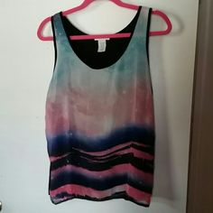 Tank top Tank top Image infront and black on the back NEVER been worn! No stains or rips! In great condition! No trade.   Can ship in bundle. Delias Tops Tank Tops