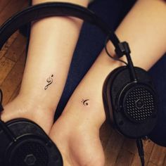 Bass and treble clef tattoos on both wrists. Tattoo artist: Jay...