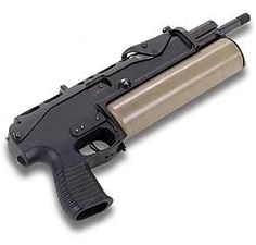 submachine gun with box magazine and adapter (left) and helical large capacity magazine(right). Self Defense Weapons, Weapons Guns, Guns And Ammo, Assault Weapon, Assault Rifle, Tactical Equipment, Tactical Gear, Battle Rifle, Submachine Gun