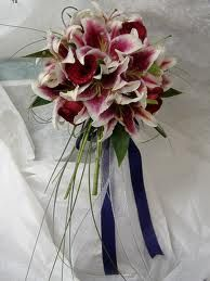 Stargazer Lily bouquet. My favorite but i'd use a different color ribbon instead of navy blue