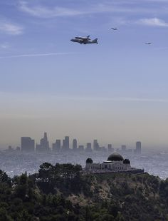 Space Shuttle Endeavor passes over the Griffith Park Observatory area as part of its final journey to Los Angeles.