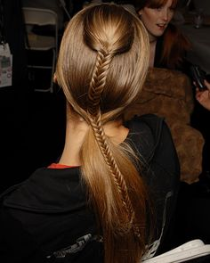 Half up fishtail hairstyle.
