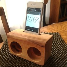 Wooden iPhone Speakers. There isn't anything to plug it, the shape and design amplify the speaker of the iphone. Great for at home, office desk, etc.