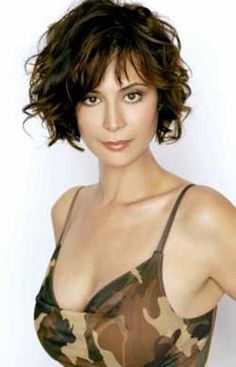 short hairstyle featuring lots of long layers and side swept bangs.. good for curly hair.  Very cute!