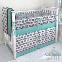 Crib bedding in Solid Teal, Solid Slate Gray, Gray Watercolor Elephants, Gray Painted Diamond. Created using the Nursery Designer® by Carousel Designs where you mix and match from hundreds of fabrics to create your own unique baby bedding. #carouseldesigns