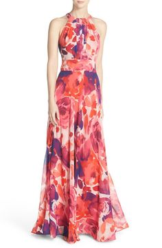 Free shipping and returns on Eliza J Floral Print Halter Maxi Dress (Regular & Petite) at Nordstrom.com. Artsy pleats create flattering shape down the halter-style bodice of a flowing chiffon maxi while the inset waist emphasizes the smallest point of your figure. Ethereal, large-scale blossoms wash the statuesque length in a warm, glowing palette.