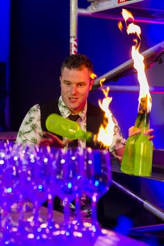Flaire bartender playing with fire!