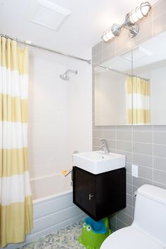 : Contemporary Bathroom Interior Design With Frameless Wall Mirror Also Black Floating Vanity And Extra Long Shower Curtains