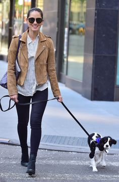 Olivia Munn walked her dog wearing skinny jeans, a striped button-up, and a camel suede moto jacket luxe enough to lust over.