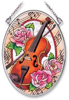 Amia Hand Painted Glass Suncatcher with Violin and Rose Design, 3-1/4-Inch by 4-1/4-Inch Oval by Amia. $11.00. Handpainted glass. Includes chain. Comes boxed, makes for a great gift. Amia glass is a top selling line of handpainted glass decor. Known for tying in rich colors and excellent designs, Amia has a full line of handpainted glass pieces to satisfy your decor needs. Items in the line range from suncatchers, window decor panels, vases, votives and much more.