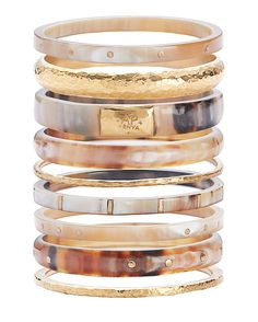 Ashley Pittman Nene Set of 9 Bangles: Light horn mix with hammered bronze and studs adorning these hand-crafted set of 9 bangles. 9 1/2 circumference and 2 3/4 wide. Slip-on & stackable style. Made in ...