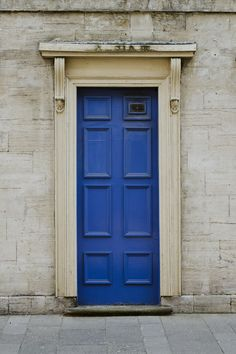 A blue door in merchant city Scotland