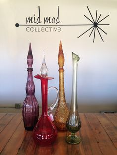 MCM Art glass vases and decanters. Available now at Mid Mod Collective. Email midmodcollective@gmail.com for more info.