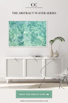 Large seafoam green abstract water art print adds a bright pop of color in an all white living room Coastal Wall Decor, Coastal Art, Beach House Decor, Coastal Living, Black Rooms, Water Art, House Art, Green Art, Print Store