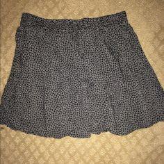 BRANDY MELVILLE luna skirt Super cute brandy melville luna skirt with daisy flowers on it. Absolutely nothing wrong with it!!! Brandy Melville Skirts