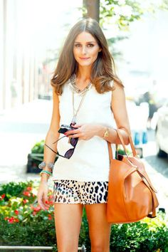 She knows how to wear leopard print. Leopard print shorts. Olivia Palermo.