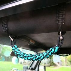Teal and Black Jeep Grab handles made to fit over the roll bars of a Jeep Wrangler. Made with 550 paracord and stainless steel D rings. Roll bar wraps will always be black unless otherwise requested. Choose from YJ, TJ or JK and choose front only or front Jeep Wrangler Tj, Jeep Jk, Jeep Rubicon, Green Jeep, Blue Jeep, Car Accessories For Girls, Jeep Accessories, Custom Jeep, Custom Trucks