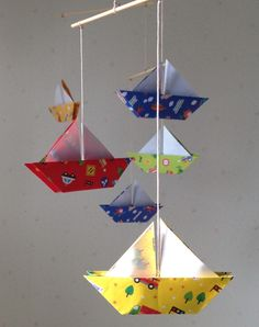 A personal favorite from my Etsy shop https://www.etsy.com/listing/257748353/6-large-origami-sailboats-mobile-6