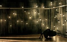 Ralph Koltai  Concrete and Wire Fencing with pendant lights! so cool!