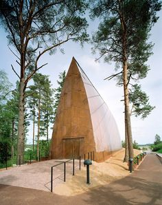 Copper-clad chapel in Finland has a curving wooden frame like a ship's hull