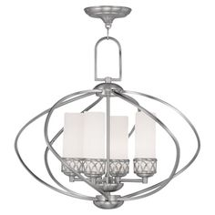 Cast a warm glow in your dining room or master suite with this lovely chandelier, showcasing twisted openwork and a hand-blown glass shade.