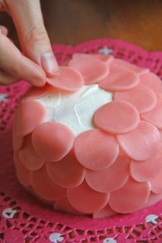 Decorate cake with pink marcipan, but I would use homemade marshmallow fondant~