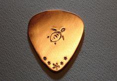 Sea turtle guitar pick handmade in copper Guitar Picks Personalized, Custom Guitar Picks, Ukulele, Cool Guitar Picks, Cheap Guitars, Guitar Accessories, Guitar Lessons, Music Stuff, Playing Guitar