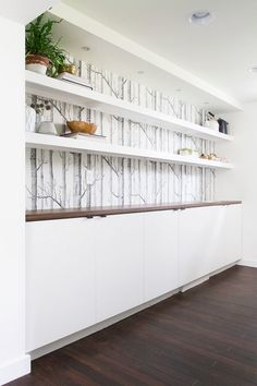 Instead of upper cabinets in kitchen, what about this idea? Wall to wall shelving. Just on one wall