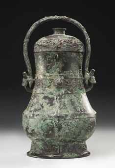 ANARCHAIC BRONZE VESSEL AND COVER (YOU)  WESTERN ZHOU DYNASTY, 11TH-10TH CENTURY BC